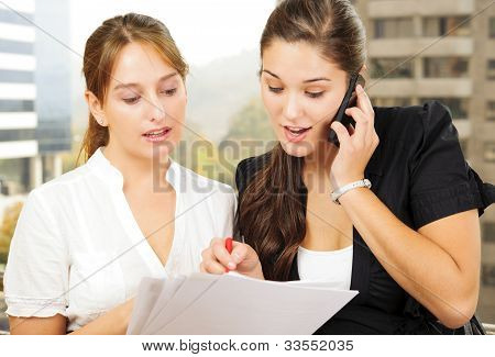 Two Women Doing Business