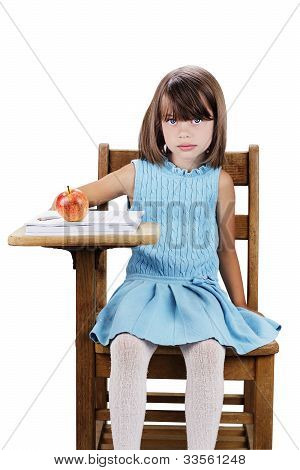 Child Sitting At School Desk