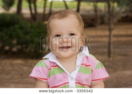 Beautiful And Happy Baby Girl Looking At Camera
