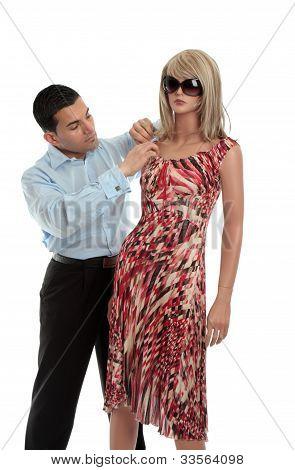 Man Dressing A Mannequin