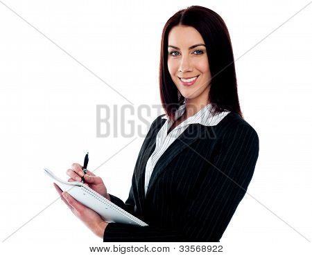 Young Beautiful Businesswoman Writing On Clipboard