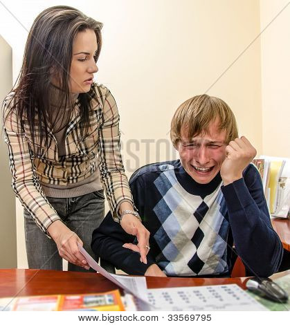 Angry Businesswoman Shouting At Her Worker