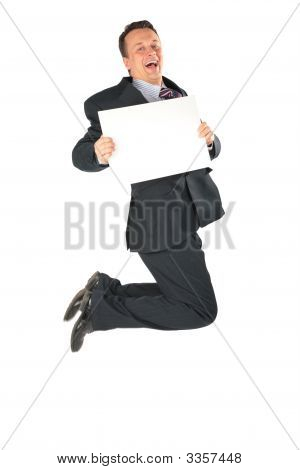 Jumping Businessman With Blank Paper
