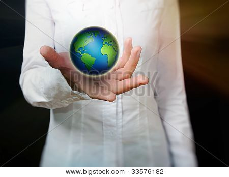 Female Hand Holding Globe Over Black Background