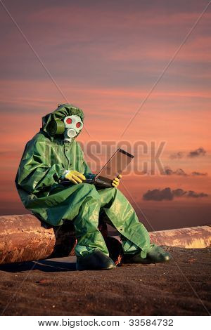 Man In Protective Suit Works In Contamination Area