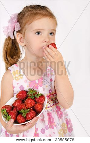 Portrait Of Cute Little Girl Eating  Strawberry