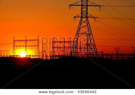 silhouette of high voltage towers