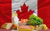 Basic Food Groceries In Front Of Canada National Flag