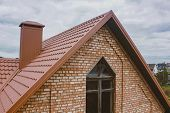 Modern Roof Made Of Metal. Corrugated Metal Roof And Metal Roofing. Beautiful Pink Brick Brick House poster
