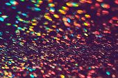 Multicolor Blurred Neon Lights Star Flares And Rainbow Glitter On Dark Background. Bokeh Lens Flare  poster