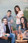 foto of bff  - Group of teens hanging out at a barbecue drinking soda - JPG