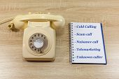 Nuisance Telephone Calls Concept - Old Fashioned Telephoned With Notepad poster