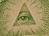 image of isosceles  - All seeing eye from 1 us dollar. Eye in a pyramid. Macro picture.