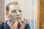 Facial Cleansing Mask. Girl Wearing A Face Mask. Ladys Beauty. Face Cleaning At Home. Facial At Hom poster