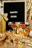 New Year Concept. New Years Eve Golden Party Table With Two Champagne Flute, Black Felt Letter Board poster