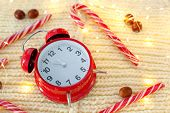 Vintage Alarm Clock On Knitted Background. Alarm Clock Shows Five To Midnight. Top View On  Christma poster
