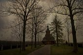 Beautiful Old Historic Historical Wooden Church On A Gray Autumn November Day, Poland poster