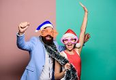 Winter Corporate Party. Office Christmas Party. Happy Man And Woman Wear Santa Hats And Funny Sungla poster