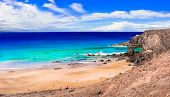 best beaches of Fuerteventura island - deserted El Cotillo in northern part of the island. Canary is poster