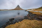 Famous Mountain With Waterfalls In Iceland, Kirkjufell, Winter In Iceland, Ice And Snow, Reflections poster