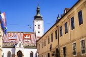 Historic Church In St. Marks Square, In Zagreb, Croatia. Roof Tiles Represent The Coat Of Arms Of Z poster