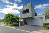 stock photo of penthouse  - Modern Australian house front on sunny day - JPG