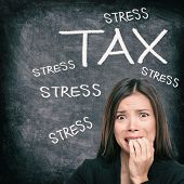 Tax season stress stressed Asian woman biting nails anxious late to file tax paperwork for IRS. Blac poster