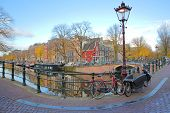 The Junction Between Prinsengracht Canal And Reguliersgracht Canal, With Autumn Colors And Colorful  poster