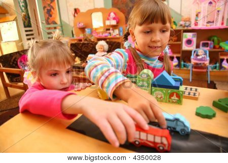 Two Girls In Playroom