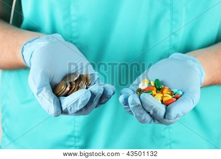 Doctor gives many different pills, on blue background