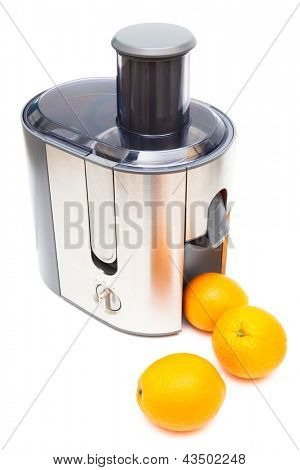 Juicer and oranges on a white background