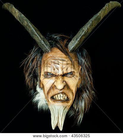 wooden satan evil mask with horns