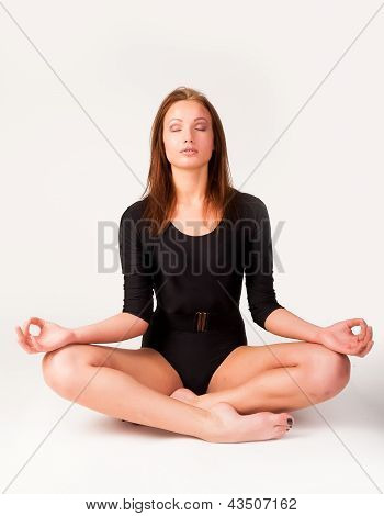 Pretty girl doing meditation exercise