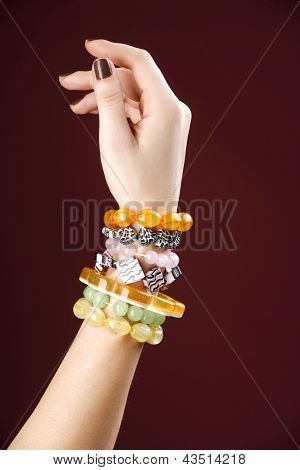 Model Hand With Fashionable Amber Bracelet