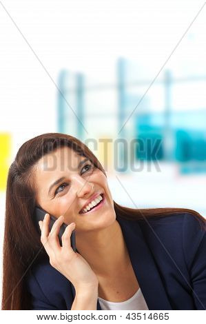 Close Up Of Young Businesswoman Looking Up And Talking With Smartphone