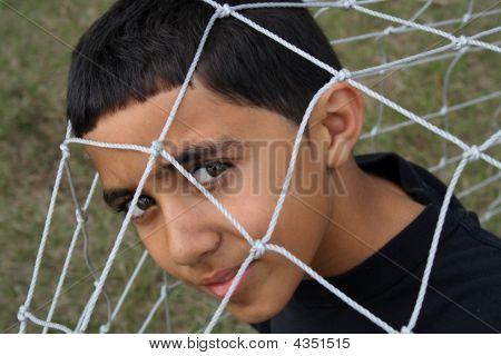Kid Under A Net