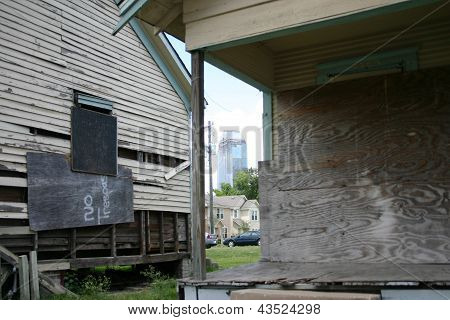 Dilapidated Buildings in Shadow of Houston Skyscrapers