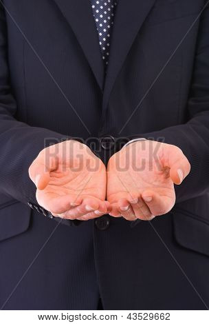 Business man holding empty hands.