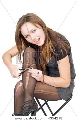 Girl With Scissors Cuts The Stockings. Isolated