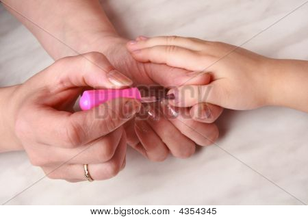 Hands Mom Causing Manicure Nail Varnish To Daughter