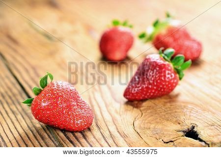 Strawberries On A Old Wooden Table