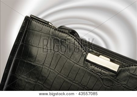 A Black Business Handbag Isolated On A Graduated Background