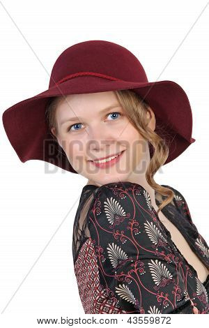 Portrait Of Young Woman In Red Hat