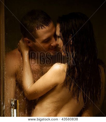 Loving couple engaged in love in a bath booth