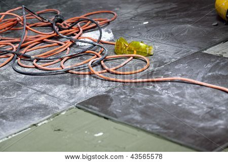 Coils Of Electrical Cable Lying On Floor Workplace