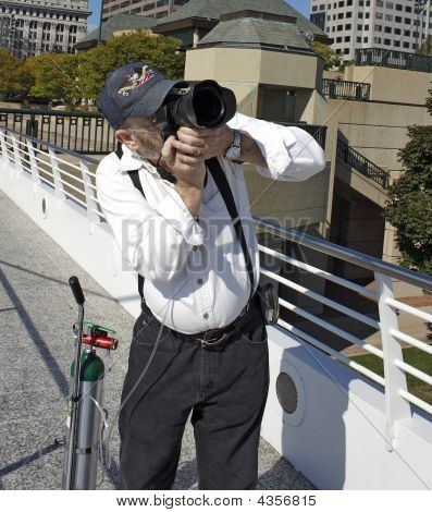Disabled Tourist With Camera