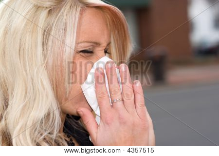 Blowing Her Nose
