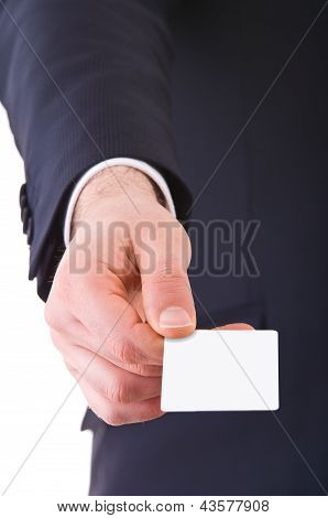 Business man offering blank card.