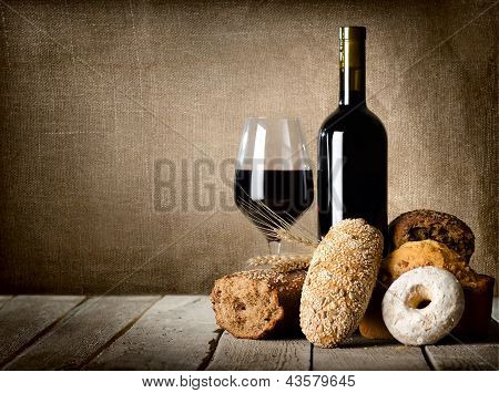 Red wine and assortment of bread