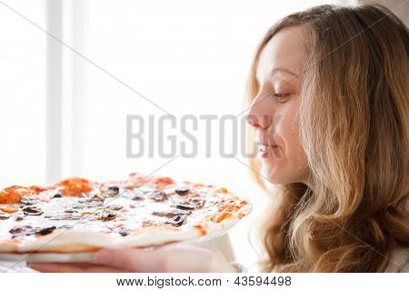 Beautiful Young Woman With Pizza In Hands